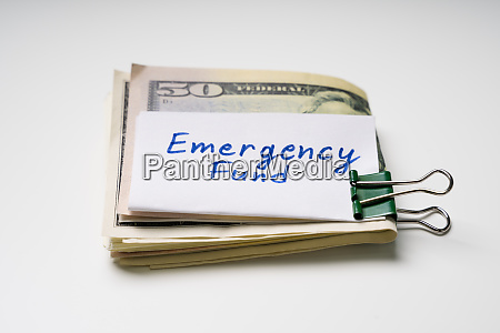 folded fifty dollar banknote and emergency