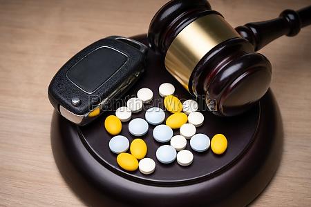 pills car key and judge gavel