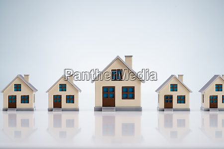 small house models arranged in row