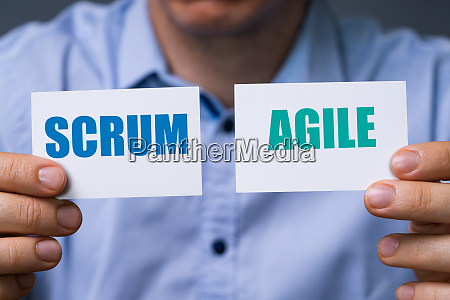 man showing scrum and agile cards