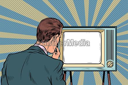 male viewer watching tv television propaganda