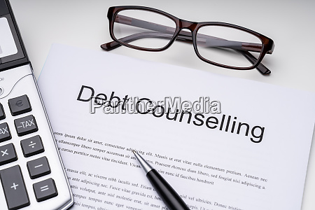debt counseling document with office accessories