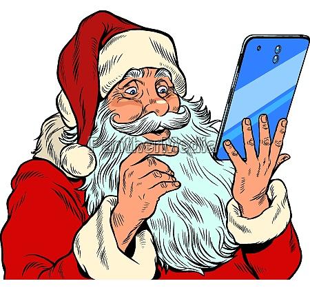 santa claus and a big smartphone