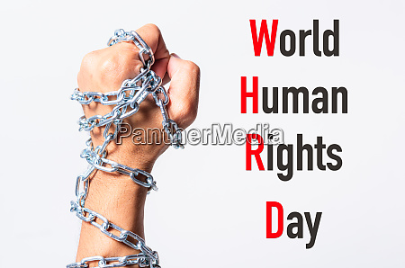 chained fist hands with world human