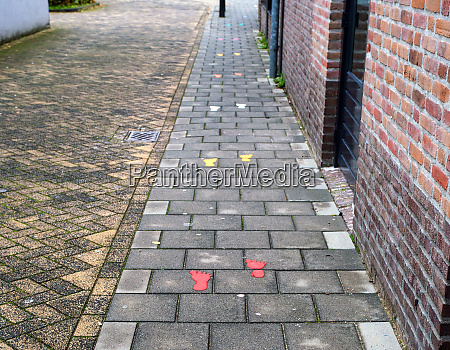 sidewalk with painted colorful footsteps for