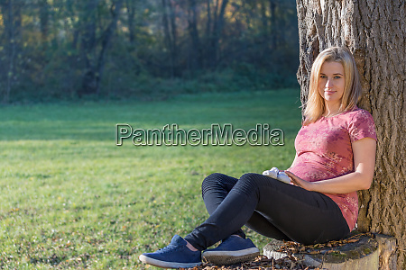 portrait of young pregnant woman is