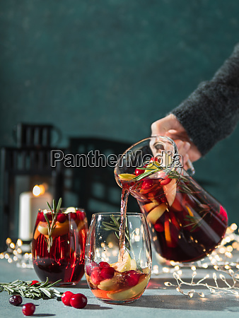 winter sangria pouring in glasses christmas