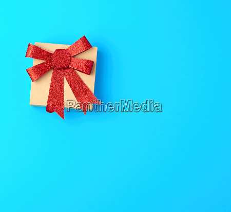 closed brown gift box with a