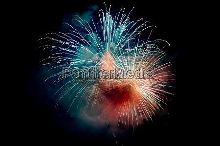 blue orange sparkling fireworks background on