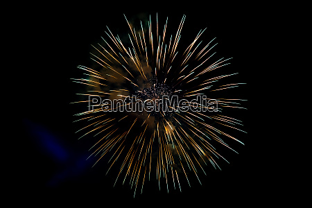 center yellow sparkling fireworks background on
