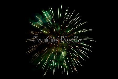 orange green sparkling fireworks background on