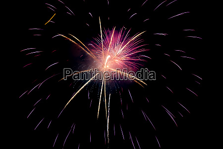 purple red yellow sparkling fireworks background