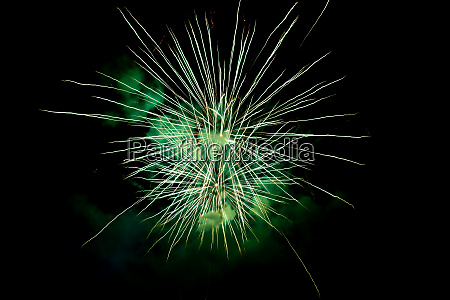 two green sparkling fireworks background on