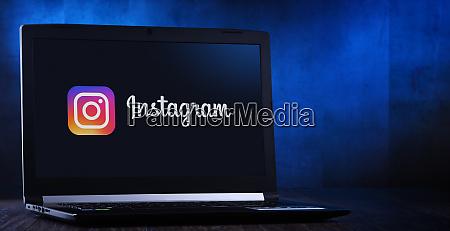 laptop computer displaying logo of instagram