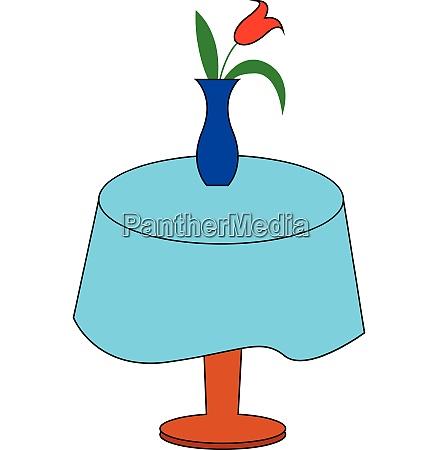 blue flower vase displaying red tulips
