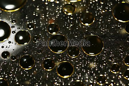 golden oil bubbles macro on water