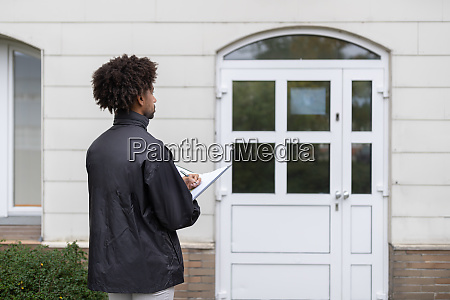 person filling document in front of