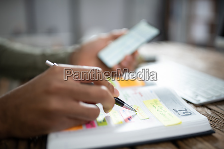 person hands with mobile phone and