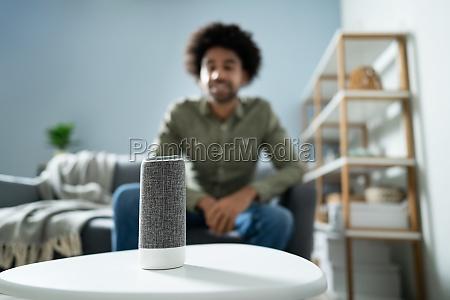 man listening wireless speaker