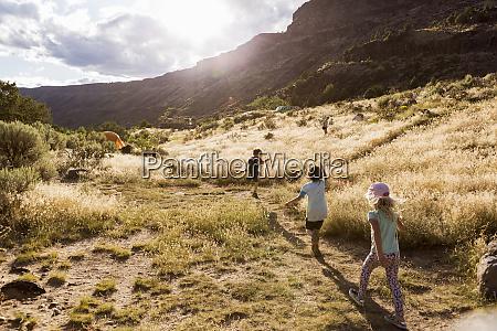 children hiking at sunset pilar nm