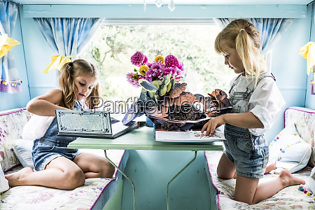 two girls sitting at a table