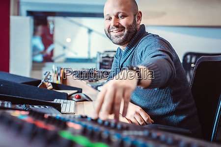 sound engineer mixing a song in