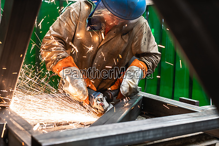 metalworker working with angle grinder