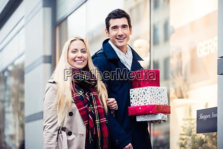 woman and man christmas shopping
