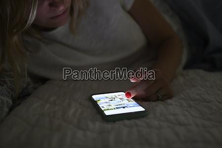 woman scrolling through social media on