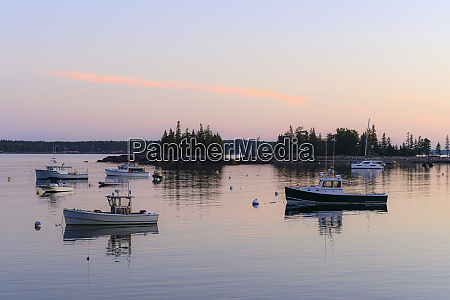 boats at sunset in seal harbor