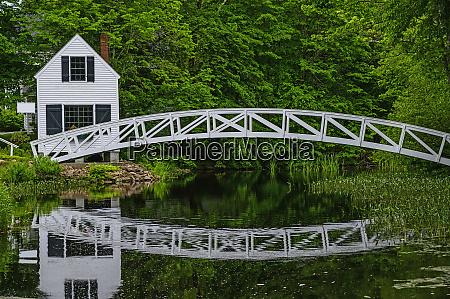 white building and bridge in somesville