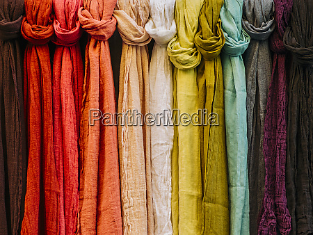 row of colorful scarves