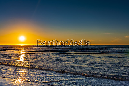 golden sunset over the pacific ocean