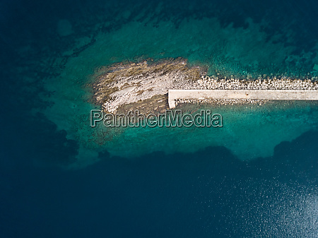 aerial view of artificial rock pier