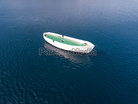 aerial view of unfinished boat anchored