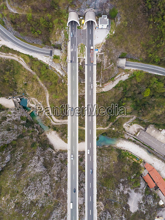 aerial view of highway crossing river