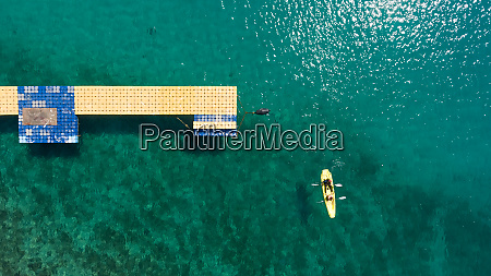 aerial, view, of, people, kayaking, near - 27539882