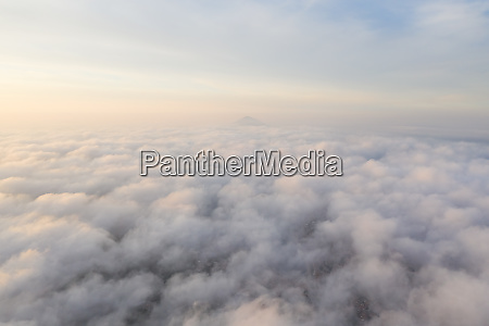 aerial view above the clouds during