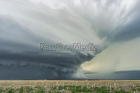 dramatic dark storm clouds over farmland
