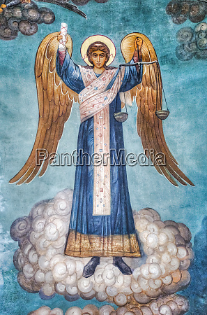 religious artwork of angel holding scales