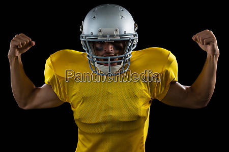 american football player flexing his muscles