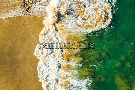aerial view of a wave breaking