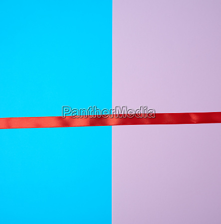 red silk ribbon on a blue