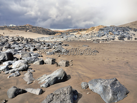 lava sand beach with large black