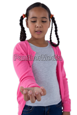 girl pretending to hold an invisible