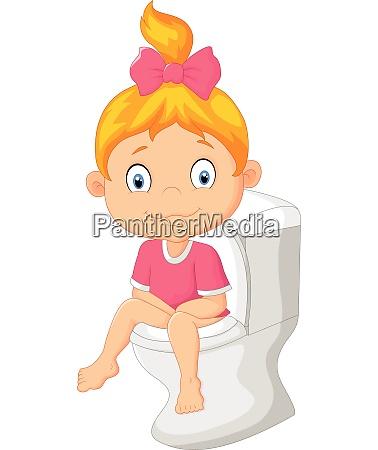 little girl sitting on the toilet
