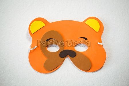 high angle view of orange mask
