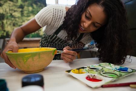 beautiful woman painting bowl
