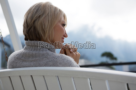 rear view of thoughtful woman relaxing