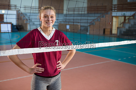 smiling female volleyball player standing with